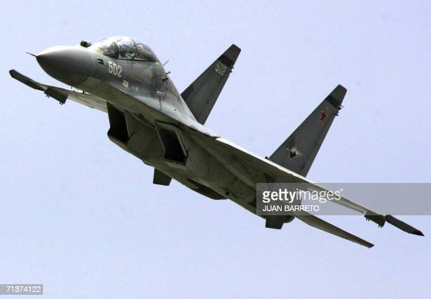 A recently acquired Sukhoi30 Russianmade fighter still wearing the Red Army cocard in the tail overflies Caracas City 05 July 2006 during a military...