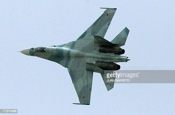 An Russianmade fighter Sukhoi30 overflies Caracas City 05 July 2006 during a military parade celebrating Venezuela's Independence day The goverment...