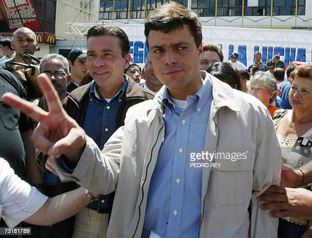 Leopoldo Lopez mayor of the Chacao municipality and founder of the opposition party Justicia Primero flashes the V sign after announcing the division...