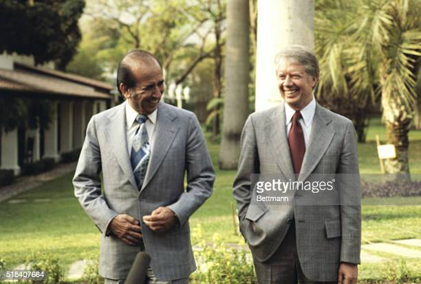 President Carter and President Carlos Perez of Venezuela leave the presidential palace after bilateral talks 3/28