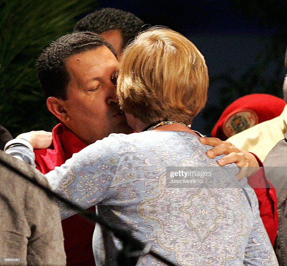 US activist Cindy Sheehan kisses Venezuelan President Hugo Chavez during a conference of the World Social Forum in Caracas 27 January 2006 Thousands...