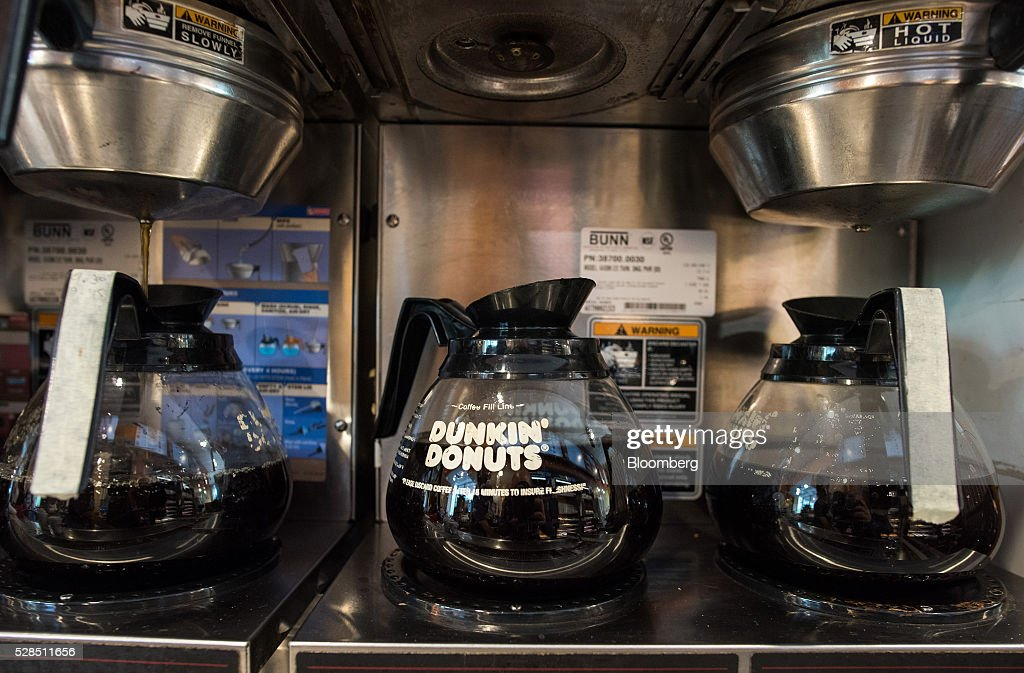 Carafes of coffee sit at a Dunkin' Donuts Inc. location in Ramsey, New Jersey, U.S., on Thursday, May 5, 2016. Dunkin' Brands Group Inc., a leading franchiser in the quick service restaurants (QSR) sector, operates in almost 60 countries around the world with more than 11,300 Dunkin' Donuts restaurants and 7,500 Baskin-Robbins locations. Photographer: Ron Antonelli/Bloomberg via Getty Images