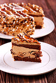 Caramel and nut layered cake, sliced on plate