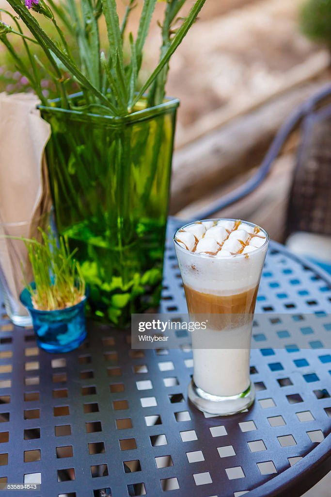 Caramel cappuccino coffee glass on table in cafe : Stock Photo