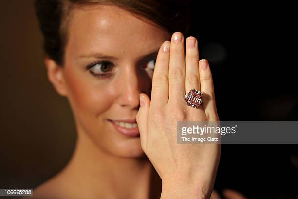 Carat Fancy Intense Pink Diamond estimated to be worth USD2738 million is modelled by a Sotheby's jewellery employee during the Sotheby's Magnificent...