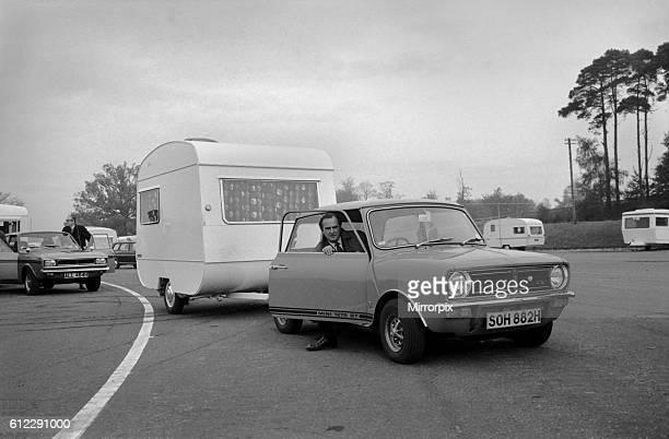 A caravan being towed by a mini clubman car November 1969 Z10726005