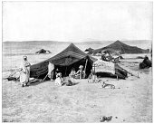 Caravan camp Sahara Desert late 19th century Berber or Bedouin family and their tents Photograph from Portfolio of Photographs of Famous Scenes...