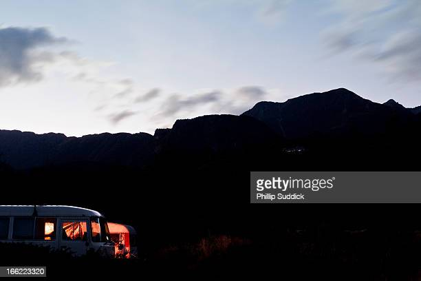 Caravan camping at night in New Zealand mountains