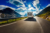 Caravan car travels on the highway. Tourism vacation and traveling.