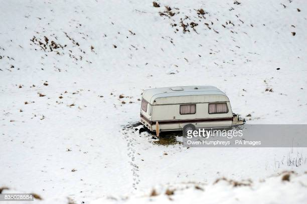 A caravan in deep snow near Cowhill weardale Co Durham as wintry weather continues to hit parts of the UK