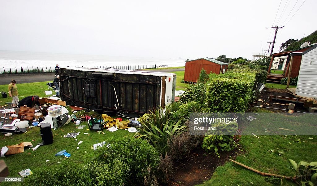 A caravan lies on its side after being lifted off the ground by a tornado on July 6 2007 in the seaside town of Oakura south west of New Plymouth New...