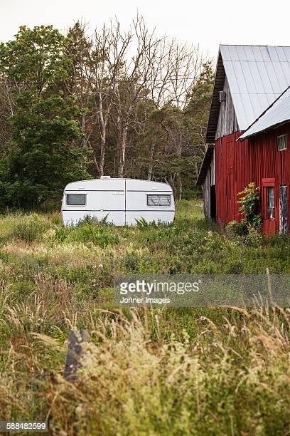 Caravan near wooden house