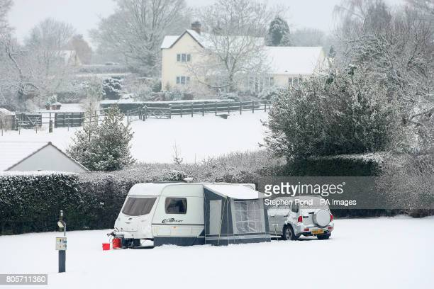 A caravan on a campsite after heavy snowfall near the town of Bewdley in Worcestershire
