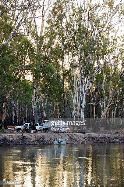 Caravan on shore of Murray River.