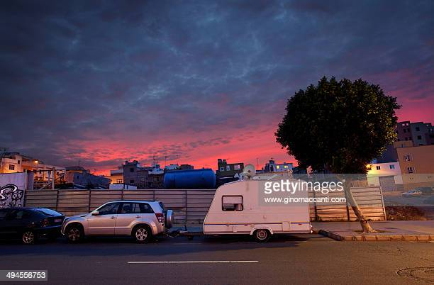 Caravan parked at dusk.