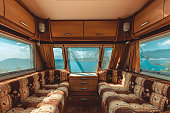 Caravan trailer with sea view, view from the inside, point of view shot. Road trip adventure