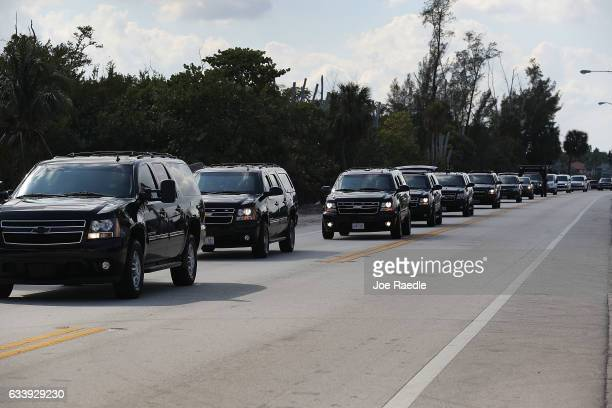 A caravan with the vehicle carrying US President Donald Trump is seen as it makes its way to the MaraLago Resort where he is staying for the weekend...