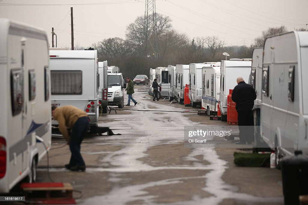 Caravans are parked close together on the perimeter road of the Dale Farm traveller's camp, a portion of which was cleared of residents and structures by Basildon Council on February 13, 2013 in Crays Hill, England. Basildon Council have approved a new site to accommodate the displaced travellers, which lies less than 800 meters from Dale Farm. Following Basildon Council's eviction in October 2011, which was estimated to have cost 7 million GBP, many travellers now reside on the access road for the legal portion of the Dale Farm site.