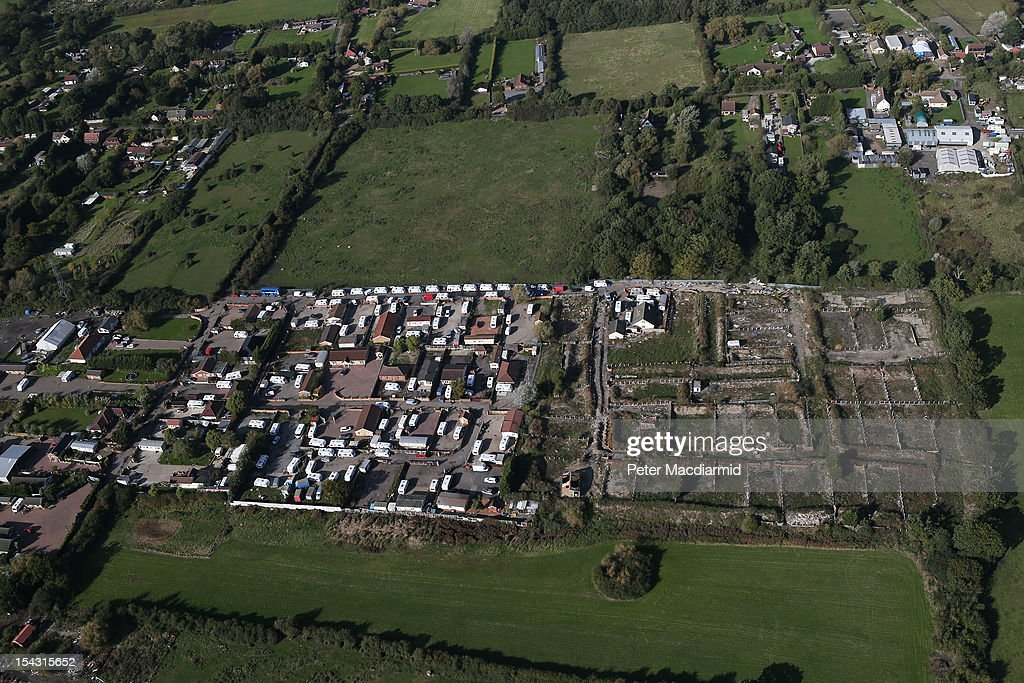 Caravans line an access road to the now empty illegal Dale Farm travellers site with the legal part of the site on the left of this aerial photograph...