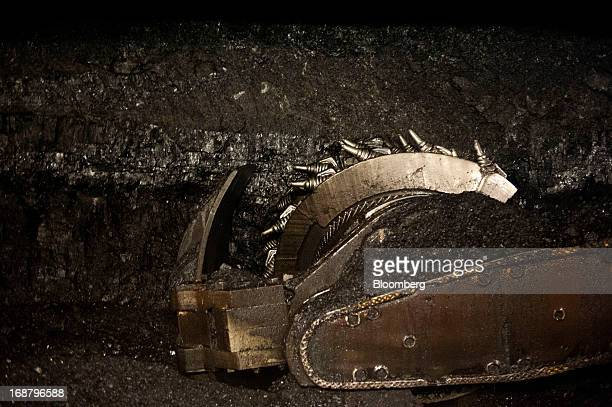 A carbidetipped shearer scrapes coal from the wall during longwall coal mining operations at the Consol Energy Bailey Mine in Wind Ridge Pennsylvania...