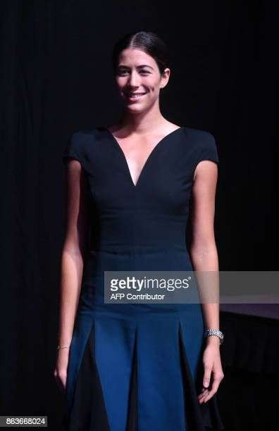 Garbine Muguruza of Spain poses for photographers duirng the Official Draw Ceremony of the WTA Finals Singapore on October 20 2017 The WTA Finals...