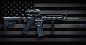 M4A1 Carbine with ACOG M150 optic commonly carried by US Military personnel, as well as US civilians in semi-auto configuration commonly known as the AR-15.  These were made by Colt Firearms and FN(Fa