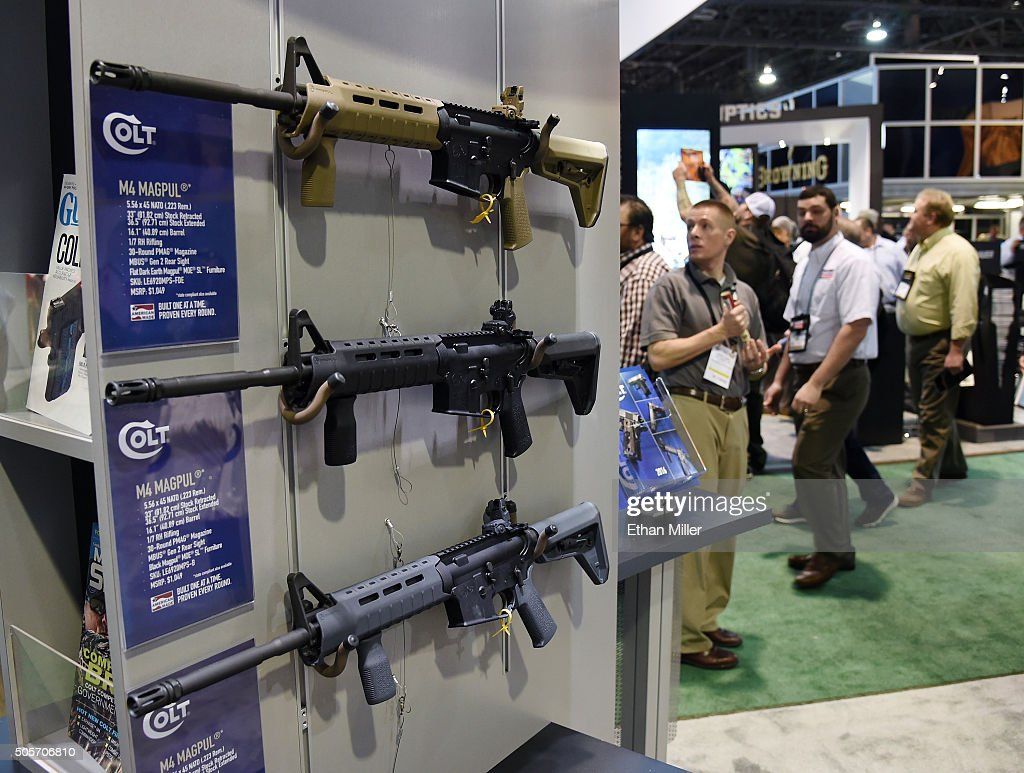 M4 carbine rifles are displayed at the Colt booth at the 2016 National Shooting Sports Foundation's Shooting Hunting Outdoor Trade Show at the Sands...