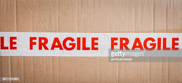 Carboard box with fragile tape : Stock Photo
