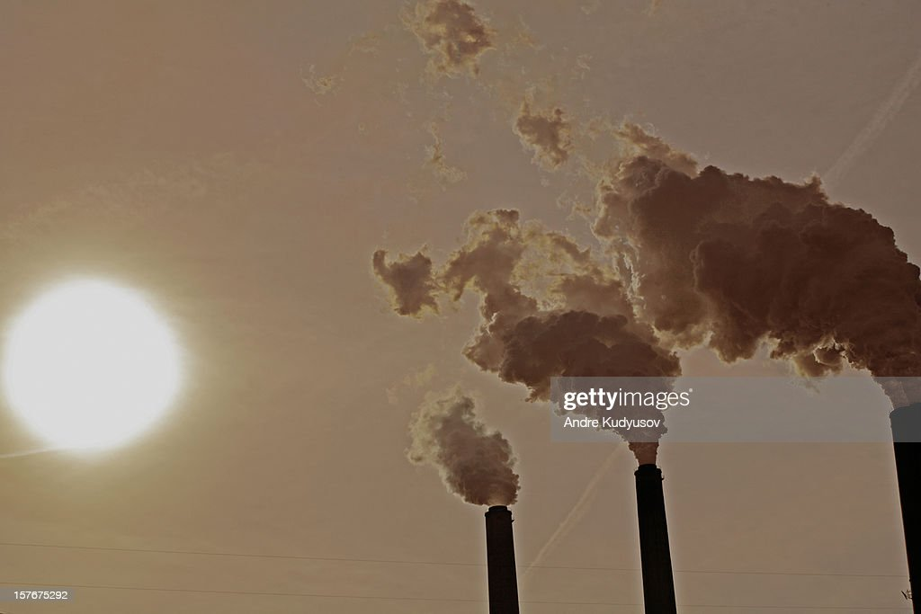 Carbon dioxide emissions from a power plant : Stock Photo