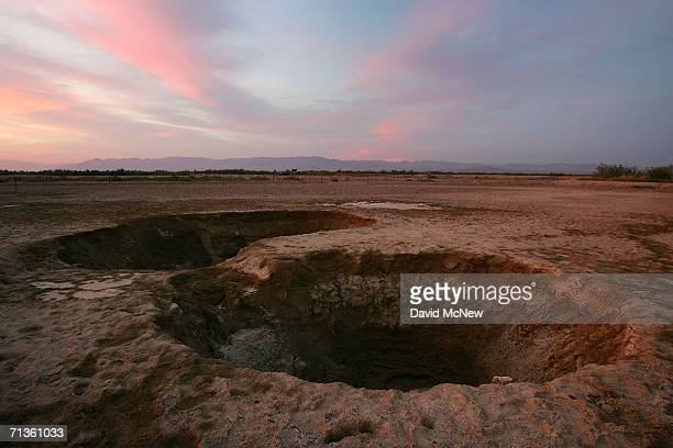 Carbon dioxide gas escaping from underground fissures bubbles up from geothermal mudpots or ''boiling mud pots'' near the southern end of the San...