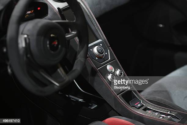 Carbon fibre and leather trim sits on the center console of a McLaren 675LT super car manufactured by McLaren Automotive Ltd as it sits on display...