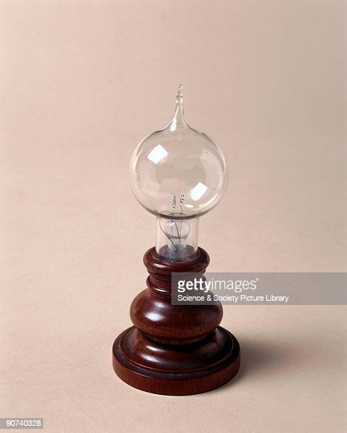 A carbon filament lamp of the type invented by Thomas Alva Edison with platinum screw clamps to hold the filament which is broken