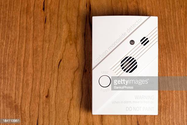 Carbon Monoxide Detector on Cherry Wood