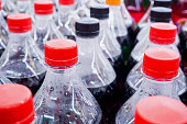 Carbonated soft drink bottles close up