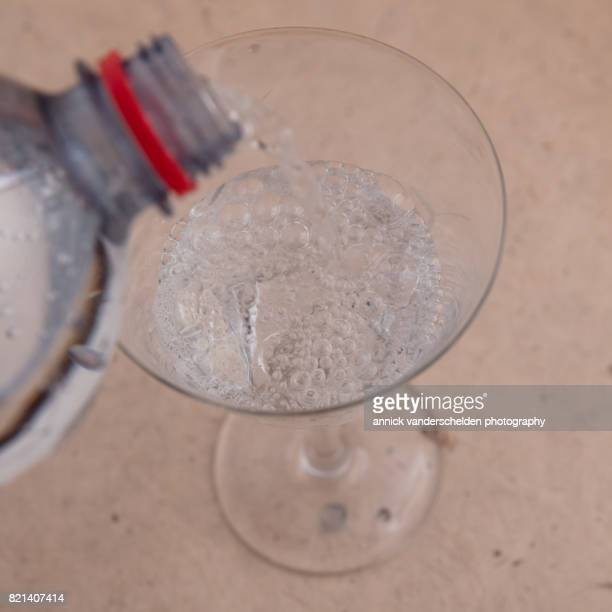 Carbonated water in a glass.