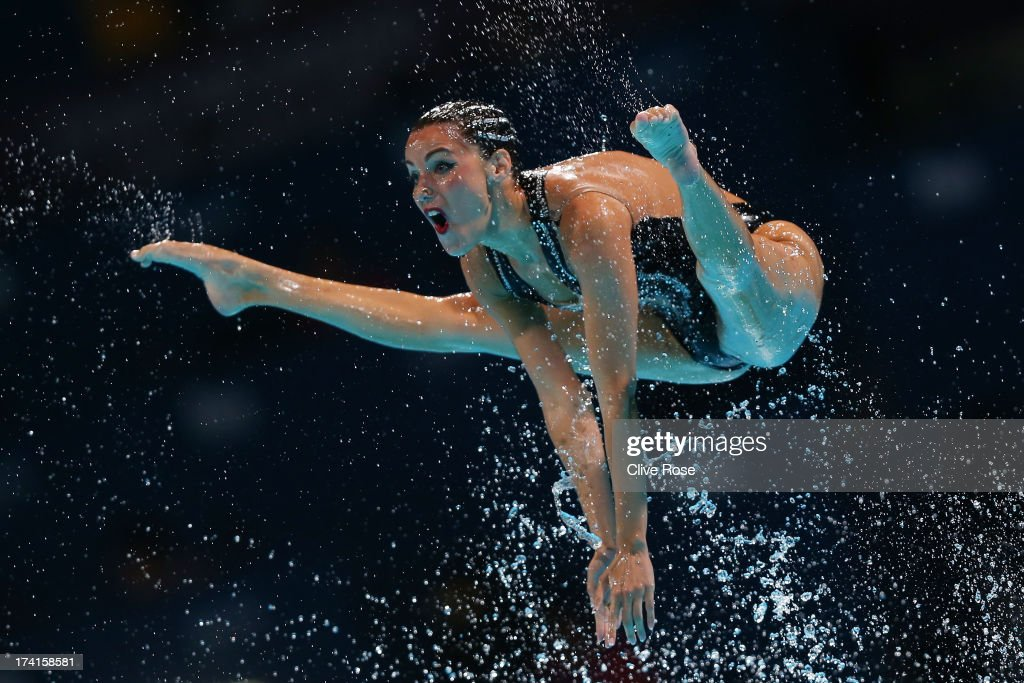 Carbonell Ballestero of Spain competes in the Synchronized Swimming Free Combination preliminary round on day two of the 15th FINA World...