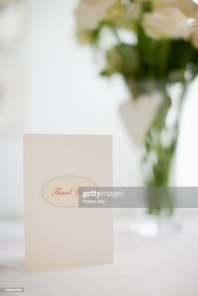 Card and bouquet of white roses