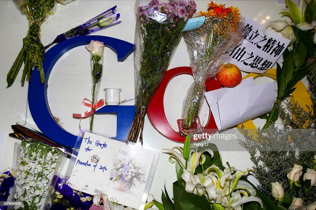 A card and flowers are placed on the Google logo at its China headquarters building on March 23, 2010 in Beijing, China. Google has closed its Chinese-language search engine Google.cn by redirecting visitors to its servers in Hong Kong.