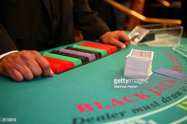 A card dealer prepares a table at Night of Las Vegas Decadence at Bloomingdales on March 18 2004 in New York City