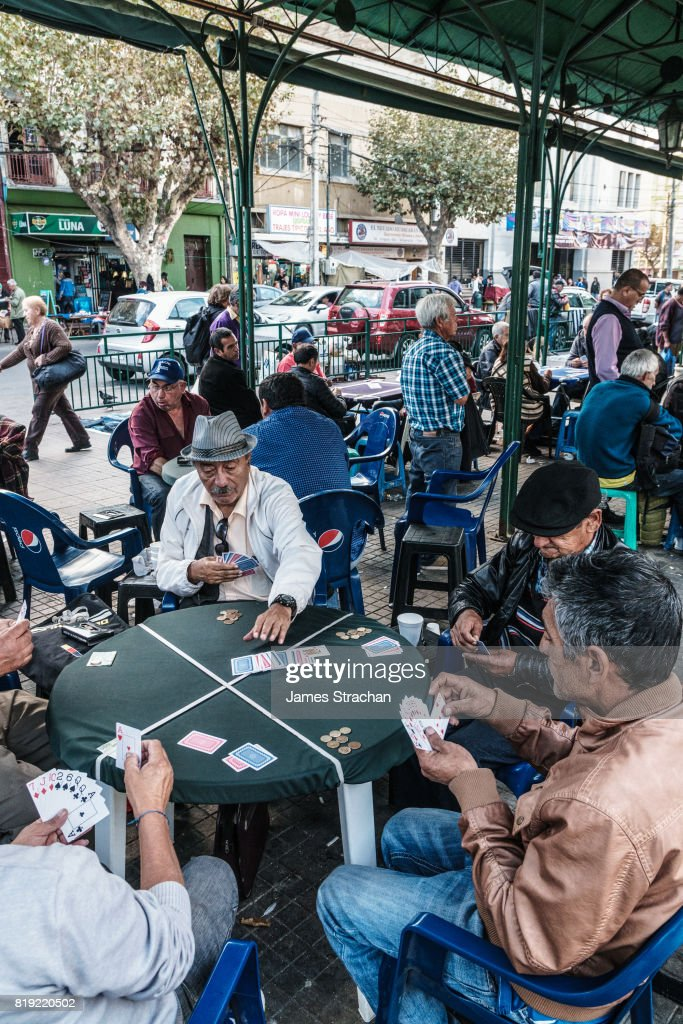 Card players gather out in public by the main bus station, Valparaiso, UNESCO World Heritage Site, Chile : Stock Photo