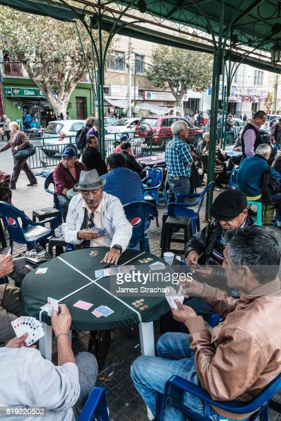 Card players gather out in public by the main bus station, Valparaiso, UNESCO World Heritage Site, Chile