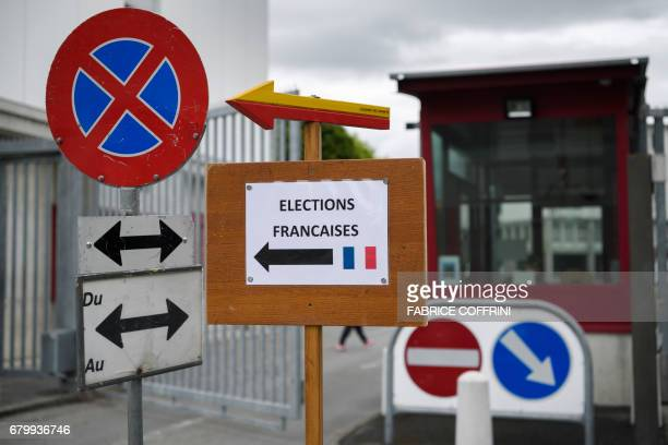 A card reading in French 'French Elections' is seen on May 7 2017 in Geneva at the entrance of Les Vernets Swiss army base hosting a polling station...