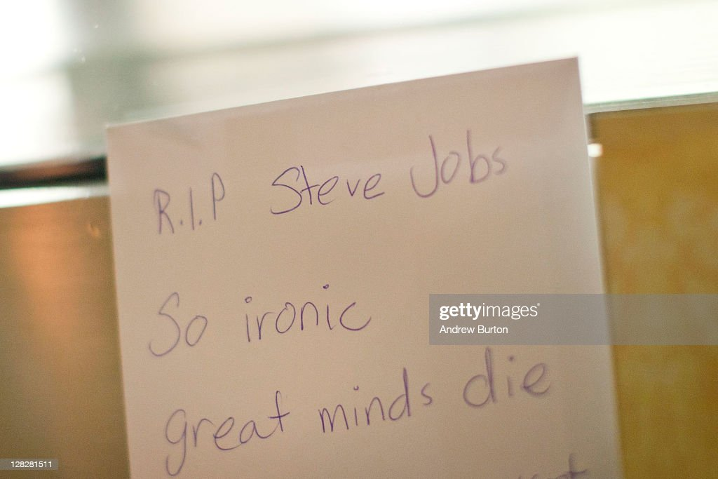 A card reading 'R.I.P. Steve Jobs' sits outside the Apple Store on West 66th Street on October 5, 2011 in New York City. Jobs, 56, passed away October 5, 2011 after a long battle with pancreatic cancer. Jobs co-founded Apple in 1976 and is credited, along with Steve Wozniak, with marketing the world's first personal computer in addition to the popular iPod, iPhone and iPad.