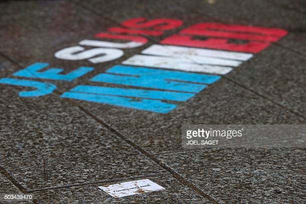 A card with the name of Francois Hollande and the message 'I am Ahmed' are seen on the ground on January 5 2016 after a ceremony to unveil a...