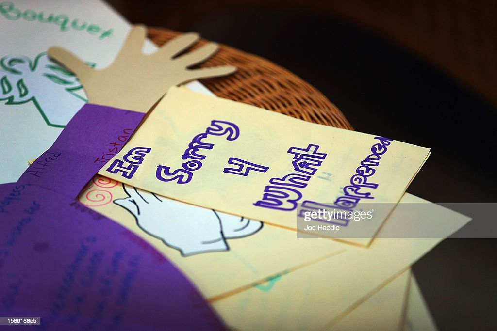 A card written by a student at St. Rose of Lima School reads, ''Im Sorry 4 What Happened'' on a card to be sent to the victims of the school shooting in Newtown, Connecticut on December 21, 2012 in Miami, Florida. Across the country people marked the one week point since the shooting at Sandy Hook Elementary School in Newtown, Connecticut that killed 26 people.