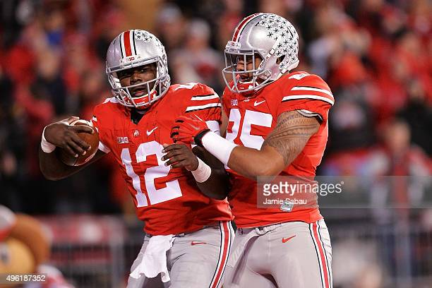 Cardale Jones of the Ohio State Buckeyes celebrates his fourth quarter touchdown run against the Minnesota Golden Gophers with teammate Marcus Baugh...