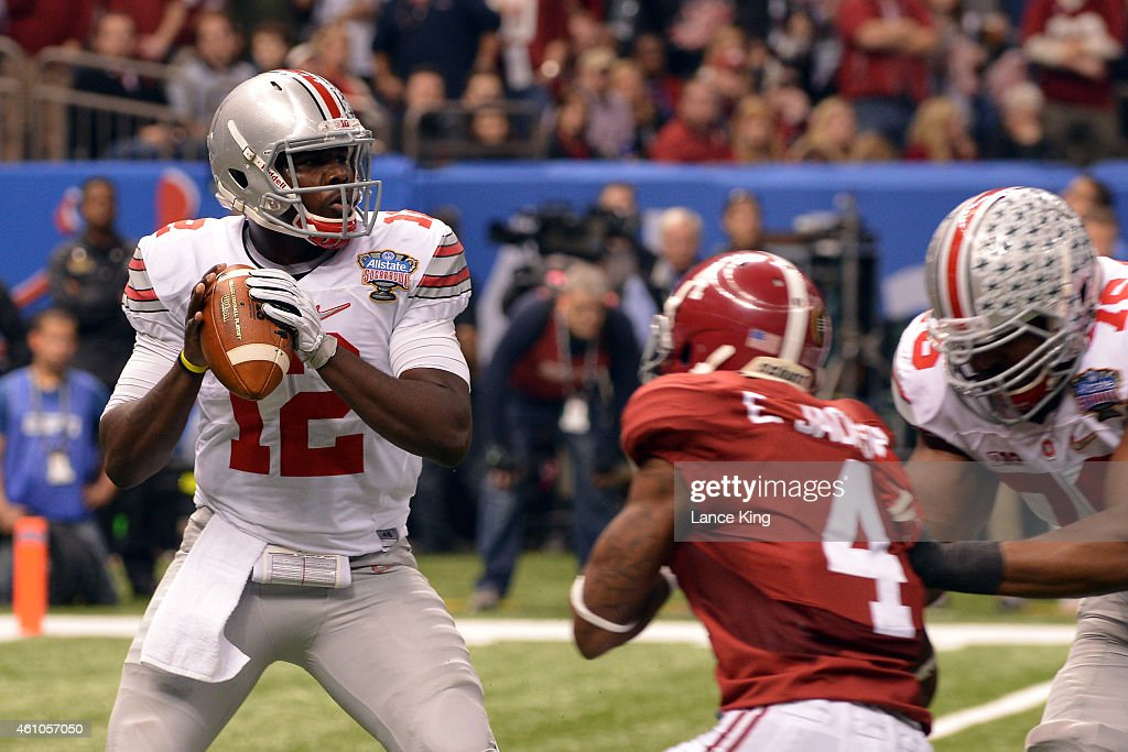 Cardale Jones of the Ohio State Buckeyes drops back to pass against the Alabama Crimson Tide during the Allstate Sugar Bowl at the MercedesBenz...