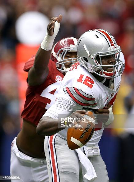 Cardale Jones of the Ohio State Buckeyes gets sacked by Xzavier Dickson of the Alabama Crimson Tide in the first quarter during the All State Sugar...