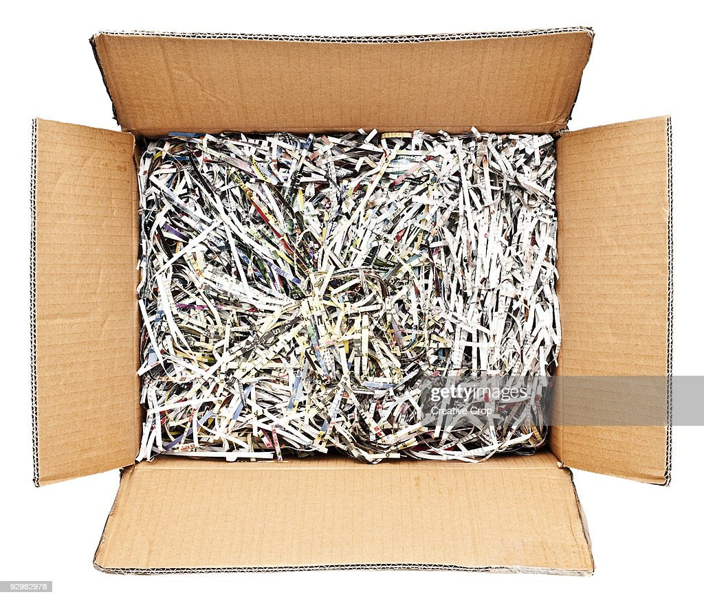 Cardboard box filled with shredded paper : Stock Photo