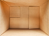 Cardboard box interior. Wide angle detailed top view